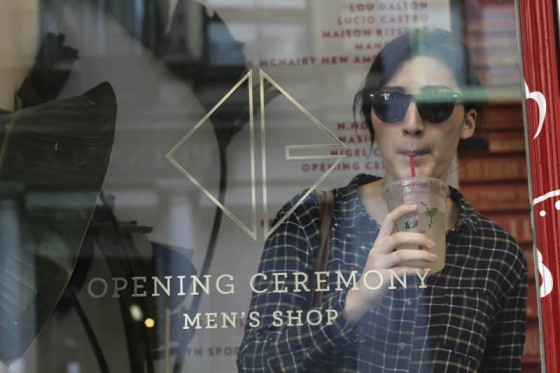 Maddy Budd in her new Warby Parker sunglasses, drinking Mint Lemonade at the Opening Ceremony men's shop.